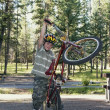Boy Plays With His Bike In A Campground — Stockfoto