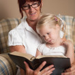 Grandmother Reading The Bible To Her Granddaughter — Stock Photo #31948971