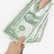 Hands Pulling Dollar Bills — Stock Photo