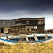 Stockfoto: Dilapidated Boathouse And Boat, Beadnell, Northumberland, England