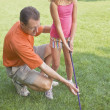 Father And Daughter Playing Golf In A Park — Stock Photo