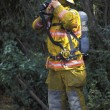 Fireman Putting On Equipment — Foto de Stock