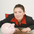 Stock Photo: BusinesswomWith Hands On Top Of Pile Of Pennies