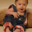 Stock Photo: Baby Reclining In Overalls