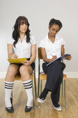 Girl Copying Another Girl's Schoolwork — Stock Photo