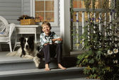 Boy Sitting With Dog On Porch Steps — Stock Photo