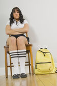 Unhappy Student Sitting On School Chair — Stock Photo