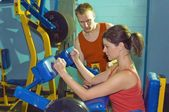 Two People At Gym Working Out — Stock Photo