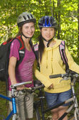 Two Cyclists Standing Beside Their Bikes — Stock Photo