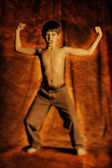 Boy Flexing His Muscles — Stockfoto