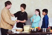 Teenagers Serving A Meal To A Man — Stock Photo