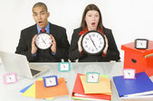 Colleagues Holding Clocks — Stock Photo