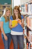 Two Young Women In A Library — Stock Photo