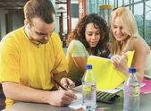 College Students Working On Assignments And Studying Together — Stock Photo