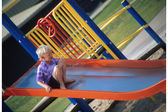 Child Going Down A Slide — Foto Stock