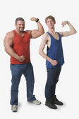 Muscular Man And Skinny Man Flexing Their Biceps — Stock Photo