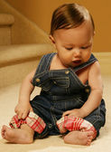 Baby Sitting In Overalls — Stock Photo