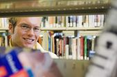 Young Man In A Library — Stock Photo