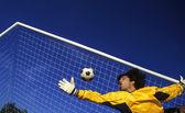 Goalkeeper catching a ball — Stock Photo