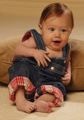 Baby Reclining In Overalls — Stock Photo