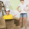 Man Inside A Cardboard Box Beside Annoyed Woman — Stock Photo