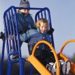 Stock Photo: Children ride on slide