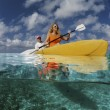 Stock Photo: Tourists traveling by kayak