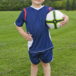 Boy Holding A Soccer Ball — Stock Photo