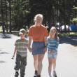 Woman Walks With A Boy And Girl In A Campground — Stock Photo