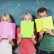 Stock Photo: Three College Students By Chalkboard
