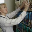Stock Photo: Looking For Patient's Records