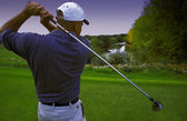 Follow Through Of Golfer's Tee Shot — Stock Photo