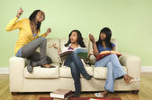 Students Doing Homework In Living Room — Stock Photo