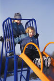 Children ride on the slide — Stock Photo