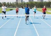 Runners On A Race Track At Finish Line — Stock Photo