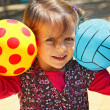 Girl with two balls — Stockfoto #31968241