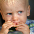Little boy eating a melon — Stock Photo #32318543