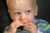 Little boy eating a melon — Stock Photo