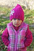 Little girl looking sulkily — Stock Photo