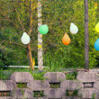 Colored balloons on the fence — Stock Photo