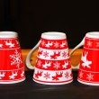 Red Christmas mugs — Stock Photo