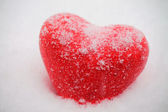 Red heart in snowfall — Stock Photo