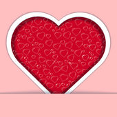 Red heart card with ornate on pink background — Stock Photo