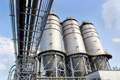 Large factory silo under blue sky — Stock Photo