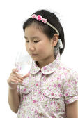 Asian girl drinking pure water on white and with clipping path — Stock Photo