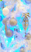 Silver balls and decorations hanging on Christmas tree — Stock Photo