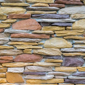Layers of colorful stones wall as texture — Stok fotoğraf