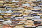 Layers of colorful stones wall as texture in landscape view — Stock Photo