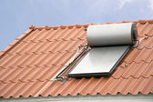 Solar panel for hot water system on roof — Stock Photo