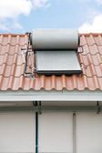 Solar panel of hot water installed on rooftop — Stock Photo